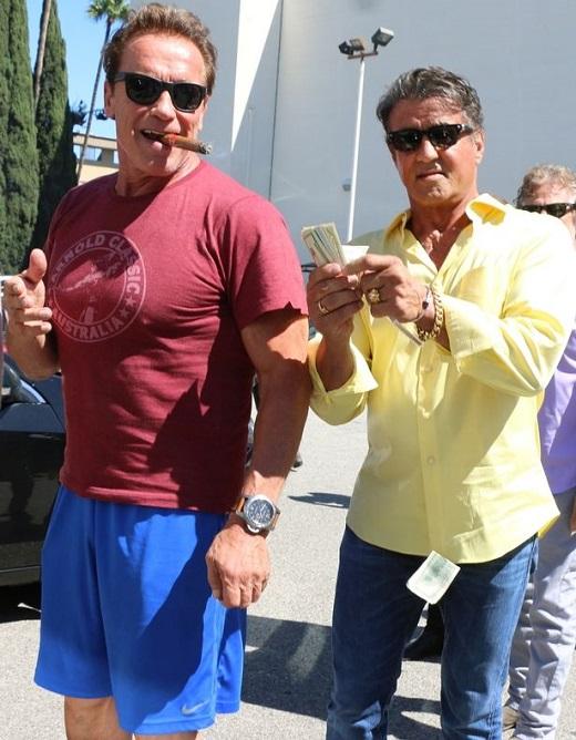 Sylvester-Stallone-making-it-rain-on-pal-Arnold-Schwarzenegger