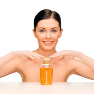 beautiful-woman-with-oil-bottle-tips-for-a-perfect-skin